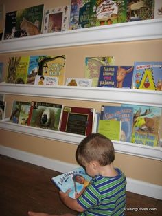 Rain gutter shelving. Awesome idea for kid book storage! Love this, no climbing or tipping over.