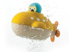 Submarine Bath Toy by Plan Toys Yellow submarine wooden bath toy by Plan Toys. Use the rubber propeller to dive deep and discover the underwater world. Encouraging imaginative play this wooden bath toy also comes with a little explorer. Water Toys, Water Play, Bath Water, Wooden Bath, Wooden Toys, Plan Toys, Yellow Submarine, Decoration Design, Shop Plans