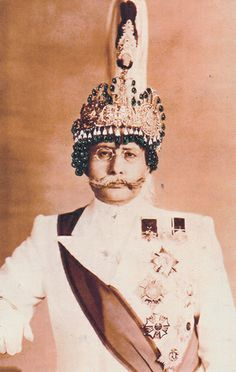 King of Nepal wearing a crown of cabochon emerald pendants and diamonds. Van Cleef & Arpels.