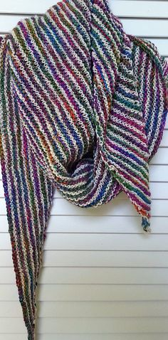 Free knitting pattern for Handspun Boomerang Shawl - Natasha Sills' shawl couldn't be easier. Use any yarn, any gauge (though she recommends handspun yarn in loose gauge.) You start with 4 stitches then repeat 2 rows until you which the size you want or run out of yarn. For striping, switch yarns with each 2 row repeat. Pictured project by barmel