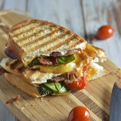 The most amazing creamy grilled cheese sandwich with roasted tomatoes, bacon and basil.