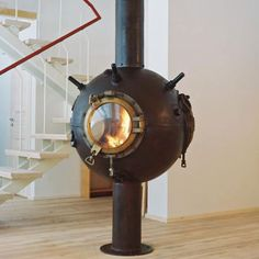 """Modified """"mine"""" from the Soviet era into a ceiling mounted fireplace."""
