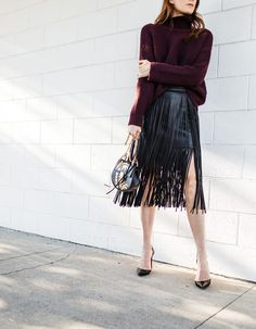 Chose to go a little dark with my colors today. However, this fringe leather skirt brought a playful feel to it. For more of my latest ensembles read up at Couldihavethat.com.
