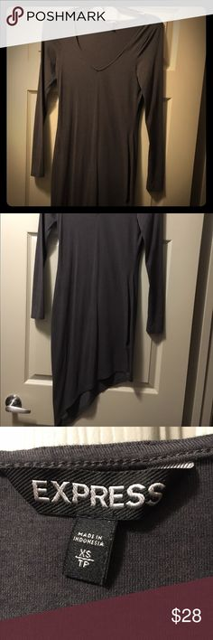 Dress This cute sexy but fancy black dress looks amazing. It's just to small for me. It has a low neck line and at the bottom it goes to a point. It's really cute. Dark grey ! Express Dresses Long Sleeve