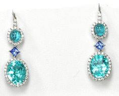 These stunning custom earrings contain Oval Paraiba, Sapphire and Diamonds.- Images Jewelers