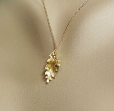 Hey, I found this really awesome Etsy listing at https://www.etsy.com/listing/233882108/gold-acorn-necklace-gold-oak-leaf