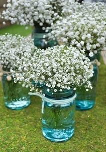 Baby's breath in blue mason jars -- super cute and inexpensive centerpieces for a rustic wedding baby shower or bridal shower!
