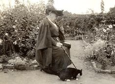 Gertrude Jekyll in her garden with a cat, Sept 1923