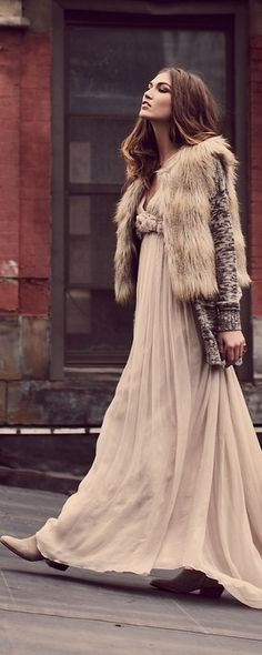 winter bohemian chic long dress, long sweater and faux fur. Middle part and wavy or. Messy up do bun