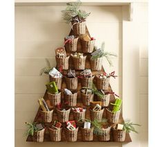 Burlap or corrugated paper wrapped cups attached to a tree-shaped piece of wood.