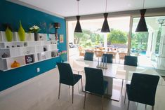 BoConcept Chaotic shelves, Snake pendants, Occa extendable table, Nico dining chairs in a beach house in South Europe