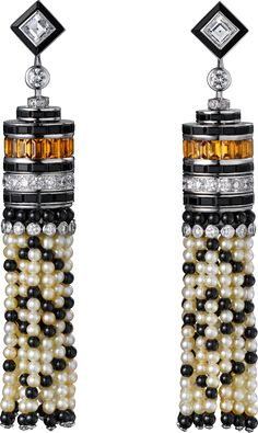 Cartier Earrings - platinum, natural pearls, calibrated yellow tourmalines, onyx, two square-shaped diamonds, brilliant-cut diamonds.