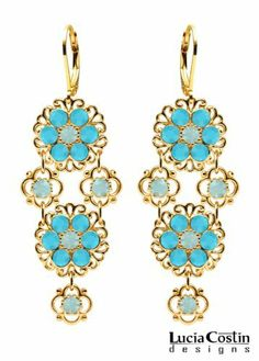 Inspiring 14K Yellow Gold over .925 Sterling Silver Flowery Dangle Earrings by Lucia Costin Designed with 4 Petal Flower Accents, Filigree Ornaments, Light Teal and Mint Blue Swarovski Crystals; Handmade in USA Lucia Costin. $90.00. Update your everyday style with inspiration when wearing this piece of jewelry. Enriched with light teal and pacific opal Swarovski crystals. A perfect feminine touch. Lucia Costin floral chandelier earrings. Unique jewelry handmade in USA