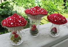 What a great idea! Old vases, fill with 'grass' - scrunched up lengths of wool maybe? and some small felt mushrooms, but them top the vase with a felted mushroom cup! How lovely do these look!!!