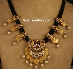 Black cord necklace with antique work peacock and round Lakshmi coins attached clasps all over. Pachi work lakshmi pendant in chandbali . Thread Jewellery, Coin Jewelry, Beaded Jewelry, Jewelry Necklaces, Ruby Jewelry, Jewelry Tree, Temple Jewellery, Diamond Jewellery, Bridal Jewellery