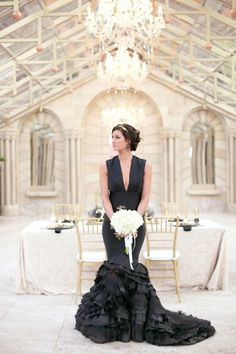 JVR Couture gown | When it comes to your wedding day, these days there's no reason why you can't rock a little black dress – or a lot of one. This opulent styled shoot features a sexy, stylish gown, a palette of black, white and gold, and luxe touches like ruffles, chandeliers and lots of glamorous gold.