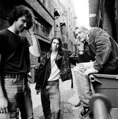 Nirvana in a Seattle alley by photographer Chris Cuffaro. March 30th, 1991.
