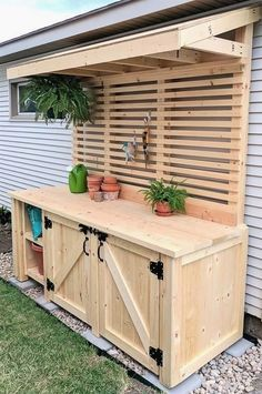 (Or backyard bar?)Shed DIY - DIY Potting Bench with Hidden Garbage Can Enclosure! Reality Daydream Now You Can Build ANY Shed In A Weekend Even If You've Zero Woodworking Experience! Station D'empotage, Potting Station, Grill Station, Cozy Backyard, Backyard Landscaping, Luxury Landscaping, Diy Landscaping Ideas, Backyard Barbeque, Sloped Backyard