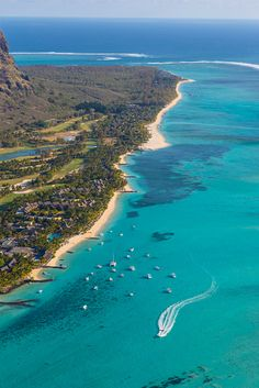 Mauritius, Riviere Noire, Le Morne Brabant, Boats in turquoise sea by coastal resort town
