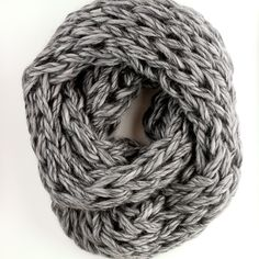 "Beautifully handmade, arm knit cowl in Rowan Drift, 100% merino wool, in heather gray. Cowl measures 12"" by 60"" loop."
