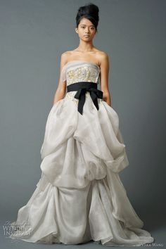dc41ecbaa3 VERA WANG Bridal Collection- Smokey ball gown with golf detail at the  bodice and black ribbon belt
