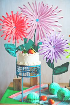 Learn how to make a paper flower that is bold, bright & beautiful. This paper flower uses large graphic lines for a look that is modern & festive. Learn how
