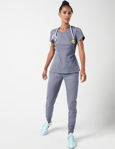 Scissor Pocket Jogger Pant in Ceil Blue is a contemporary addition to women's medical scrub outfits. Shop Jaanuu for scrubs, lab coats and other medical apparel. Scrubs Outfit, Scrubs Uniform, Girls Fashion Clothes, Clothes For Women, Stylish Scrubs, Cute Scrubs, Nursing Clothes, Medical Scrubs, Jogger Pants
