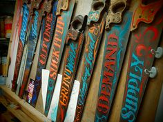 Sign painting on antique saws by Kenji Nakayama
