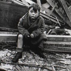 Boy who lost his family in the London blitz (taken by Toni Frissell)