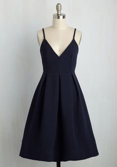 Enjoying oysters al fresco in this navy dress, you can't help but remark on what a picnic perfect ensemble it is! Topped with slim straps, a plunging V-neckline, and a pleated skirt, this textured frock will bring a smile to your face wherever it's worn!