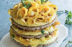 Hazelnut meringue cake with lime curd, peach and mango