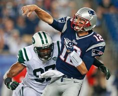 New York Jets outside linebacker Calvin Pace (97) closes in as New England Patriots quarterback Tom Brady (12) releases a pass in the first quarter of an NFL football game Thursday, Sept. 12, 2013, in Foxborough, Mass. (AP Photo/Elise Amendola)