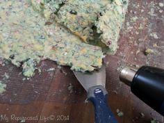 use a heat gun to remove glued carpet padding