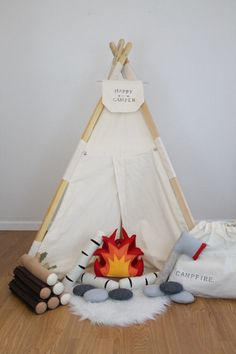 Going camping? Sleepover fun? Inside or outside, setting up the campfire will be a breeze with this interactive play set! Open fire center allows for placement of flame-less light to create optimal and safe camping experience! ---Your choice of 2 play set options, details listed below--- Fire/ 3 Logs Set ($55.50) Details Include: *1 Plush three sided self standing plush fire. Approx. 8.5 inches tall. *1 LED flame-less votive candle *3 Separate style logs: white birch, dark brown, and b...