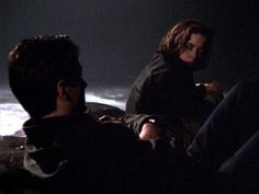 """Mulder and Scully in """"Quagmire."""" I love this scene because they're stranded, talking about anything and everything (cannibalism, for instance), and instead of being weirded out by the topic, Scully answers...and then realizes Mulder's just enjoying teasing her because he knows she'll answer seriously. 