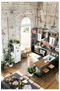 Converted warehouse makes for a stunning loft apartment. Exposed brick walls are. Converted warehouse makes for a stunning loft apartment. Exposed brick walls are soften with loads Apartment Kitchen, Apartment Interior, Kitchen Interior, Warehouse Apartment, Design Kitchen, Apartment Plants, Apartment Ideas, Apartment Design, Attic Apartment