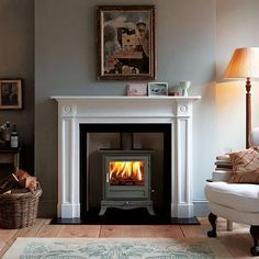 Wood burning stove that looks like a fireplace. I want a wood burning stove! Log Burner Fireplace, Wood Burner, White Fireplace, Fireplace Hearth, Fireplace Ideas, Fireplace Surrounds, Fireplace Design, New Living Room, Home And Living