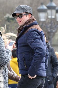 Actor and star of 'Glee' Chris Colfer visits Notre Dame and the Eiffel Tower while sightseeing with his family and boyfriend, Will Sherrod in Paris. March 2015