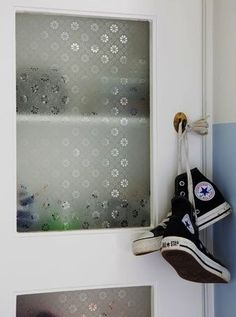 love the textured glass in the door of this cabinet