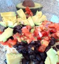 Brown rice, black bean, onions, and avocado make up this TexMex Rice and Beans recipe