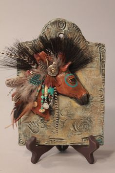 Ceramic sculpture of a Native American horse with ancient symbols