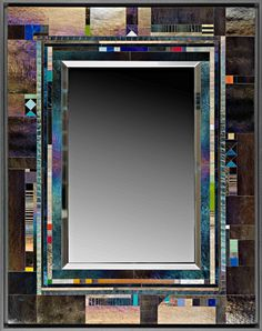 Hand cut glass pieces are precisely assembled to create this exquisite glass mosaic. The iridescent glass changes with the lighting conditions. Some glass pieces are drawn on by the artist with a kiln fired vitreous paint to establish the character of each unique mirror frame.