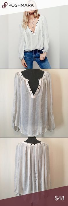 """Free People Striped V Neck Blouse d e s c r i p t i o n  In an effortless, oversized fit this sheer blouse from Free People features metallic stripes, plunging V-neckline and metal grommet detailing. Long sleeves with elastic cuffs. Slight separation in threads on back but in otherwise good condition. No Trades.   c o n t e n t  81% rayon   19% cotton  m e a s u r e m e n t s ✂️  size + L   bust + 27""""   length + 25""""  p a i r e  w i t h 🌙  + josie leather leggings 💵 bundle for a discount…"""