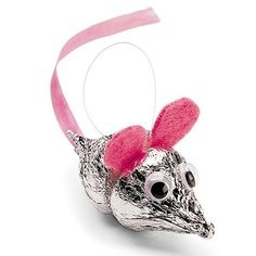 Chocolate kiss mouse party favor - good for baby shower (ears in blue/pink depending on sex of baby  Perhaps other animals could be made the same way?) or kids Cinderella-themed party