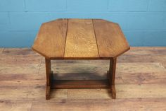 A classic Kendal Handicrafts workshop oak folding table attributed to  Arthur W. Simpson, c1920s. A very simple, beautifully crafted design that  is typical of the workshop.Made of solid oak, the table is in immaculate  condition.  Dimensions: H66.5cm, W22.5cm (stored), W81.5cm (extended), D66cm  Note: Price does not include delivery. Please use the Contact Usform for  a delivery quotation.