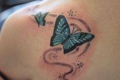 Tatuaje de dos mariposas verdes