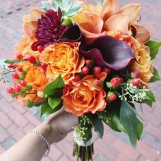 Claudia's Bouquet: <span>Free spirit roses, dahlias, calla lilies, succulents and orchids accented with hypericum berries and eucalyptus.</span>