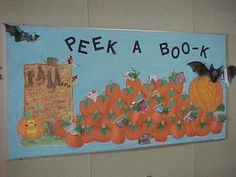"I love the creative title of this Halloween display: ""Peek a Boo-k!"" I would have students write about their favorite book inside a pumpkin template if I was creating a display with this theme. Creative Bulletin Boards, October Bulletin Boards, Halloween Bulletin Boards, Teacher Bulletin Boards, Bulletin Board Display, Classroom Bulletin Boards, Classroom Walls, Classroom Crafts, Classroom Ideas"