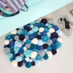Your toes with thank you for the soft comfort when you make this DIY Pom Pom Rug