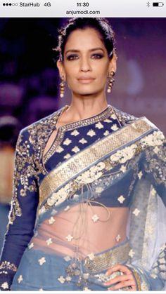 Anju Modi Angarkha style blouse in navy blue Indian Attire, Indian Outfits, Indian Wear, Saree Blouse Neck Designs, Latest Designer Sarees, Designer Dresses, Designer Blouse Patterns, Desi Clothes, Bollywood